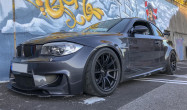"""135i/1M Conversion SM-10 Staggered Fitment<br>Front:<br>Satin Black 18x9.5"""" ET22 with 265/35-18 Toyo R888 tires and 5mm spacers<br>Rear:<br>Satin Black 18x10.5"""" ET22 with 265/35-18 Toyo R888 tires and 5mm spacers"""