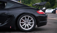 """Cayman S<br />Wheels: Race Silver SM-10 18x9"""" ET46 front, 18x10"""" ET36 rear<br />Tires: Pirelli DH slicks 265/645-18 front, 305/660-18 rear<br />Camber: -3.4º front, -3.6º rear<br />Mods: Rolled fenders"""