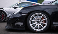 "Cayman S<br />Wheels: Race Silver SM-10 18x9"" ET46 front, 18x10"" ET36 rear<br />Tires: Pirelli DH slicks 265/645-18 front, 305/660-18 rear<br />Camber: -3.4º front, -3.6º rear<br />Mods: Rolled fenders"