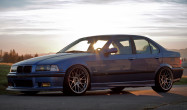 "E36 Non-M<br />Wheels: 18x9.5"" ET35 Hyper Black ARC-8<br />Tires: 245/30-18 Hankook V12<br />Mods: 5mm front & rear spacers, Rear fenders rolled"