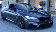 """F82 M4 SM-10 Staggered Fitment<br>Front:<br>Anthracite 18x10"""" ET25 with 275/35-18 Nitto NT01 tires<br>Rear:<br>Anthracite 18x11"""" ET44 with 305/35-18 Nitto NT01 tires"""