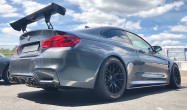 "F82 M4<br />Wheels: Satin Black EC-7 18x11"" ET25 front, 18x11"" ET44 rear<br />Tires: Pirelli slicks 305/660-18 front, 305/660-18 rear<br />Mods: 12.5mm front spacers<br />Camber: -3.5° front"