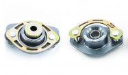 Ground Control Rear Shock Mounts. Urethane (left) and Race solid bearing (right)