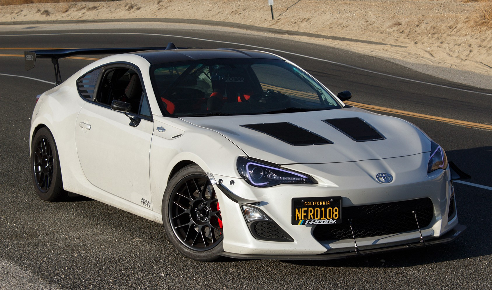 "Scion FR-S<br />Satin Black 17x9"" ET42 ARC-8 wheels with 245/40-17 Toyo R888 tires<br />Mods: 5mm front spacers, Brembo Brakes<br />Suspension: JRZ RS TWO Coilovers"