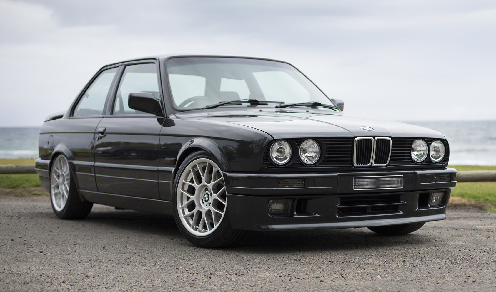"E30<br />Wheels: 17x8"" ET25 Hyper Silver ARC-8<br />Tires: 215/45-17 Bridgestone Potenza"