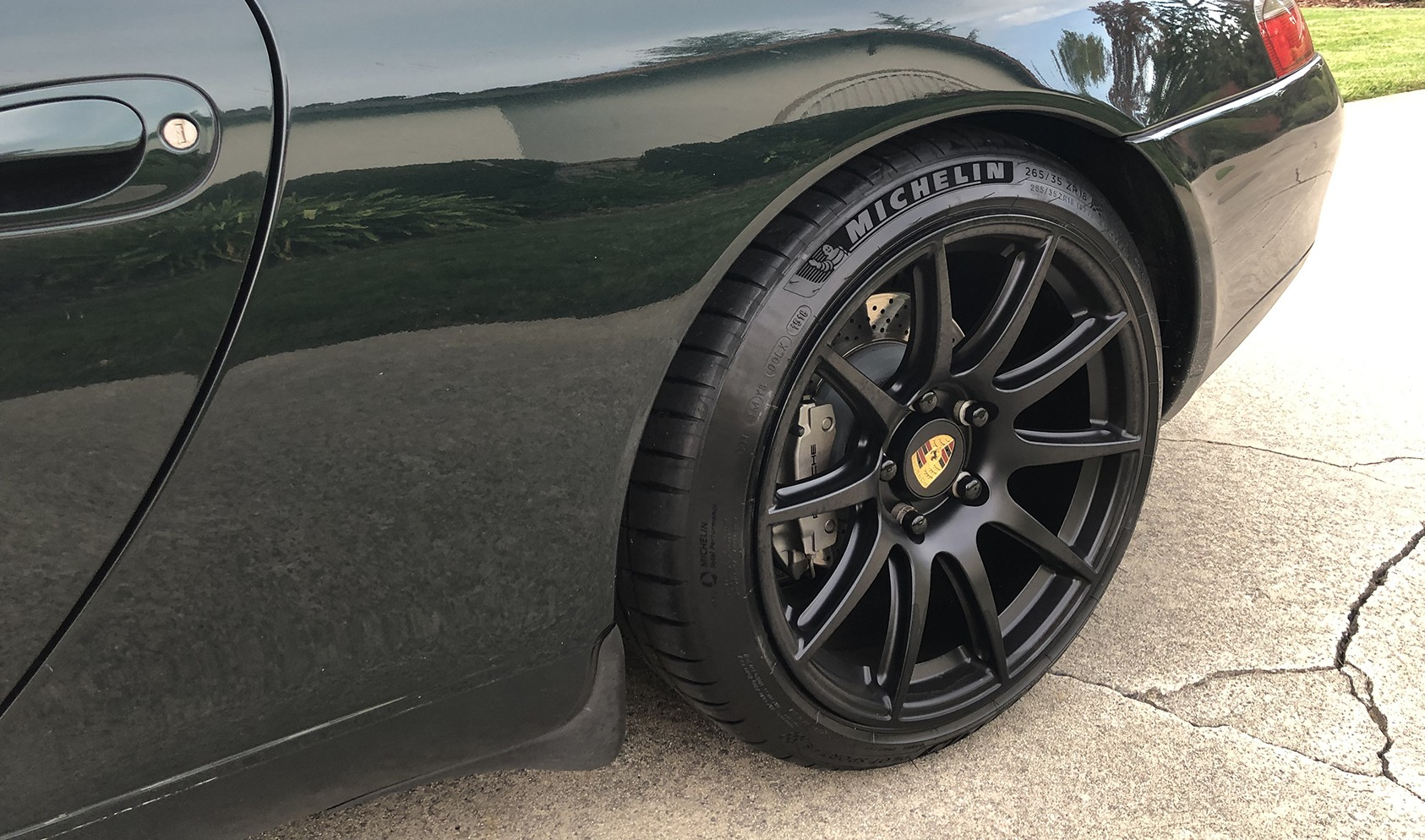 """911/996<br />Front: Satin Black 18x8.5"""" ET42 SM-10 with 225/40-18 Michelin Pilot Sport 4S & -2° camber<br />Rear: Satin Black 18x11.0"""" ET60 SM-10 with 265/35-18 Michelin Pilot Sport 4S"""