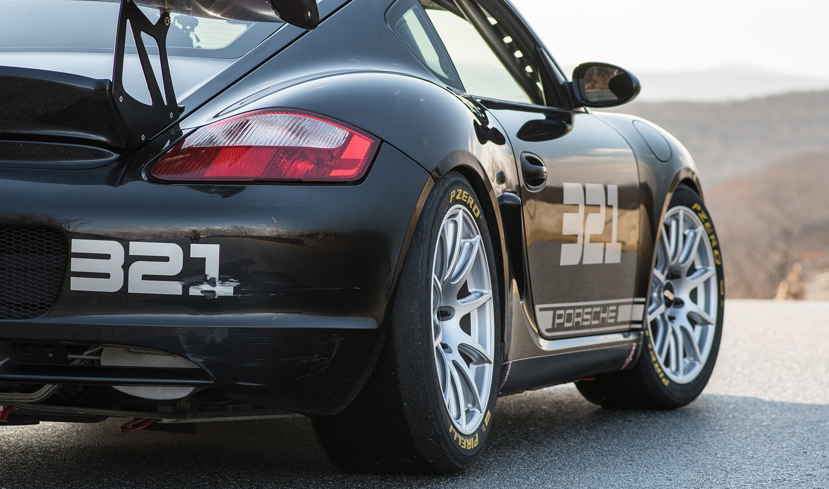 """2006 Cayman S<br />Front: Race Silver SM-10 18x9"""" ET46 with 265/645-18 Pirelli DH slicks & -3.4° camber<br />Rear: Race Silver 18x10"""" ET36 SM-10 with 305/660-18 Pirelli DH slicks & -3.6° camber"""