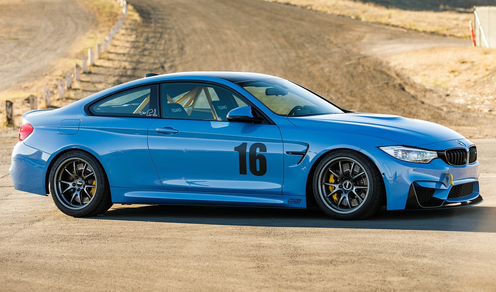 """F82 M4 FL-5 Staggered Fitment<br>Front:<br>Anthracite 18x10"""" ET25 with 275/35-18 Michelin Pilot Super Sport tires<br>Rear:<br>Anthracite 18x11"""" ET44 with 295/35/18 Michelin Pilot Super Sport tires"""